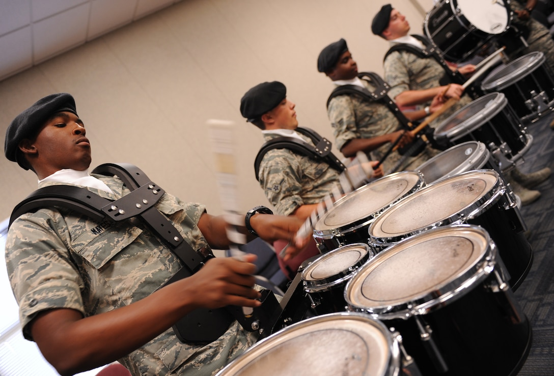 Airman Basic Deandre Mayes, 81st Training Wing Drum and Bugle Corps tenor drum player, plays a musical piece during a practice session at the Levitow Training Support Facility May 31, 2016, Keesler Air Force Base, Miss. The drum and bugle corps performs at various events such as 81st Training Group student parades and drill downs in addition to attending Air Force specialty code technical training on a daily basis. (U.S. Air Force photo by Kemberly Groue)