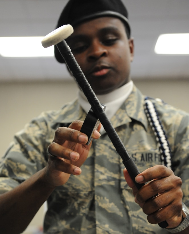 Airman 1st Class Jacari Davis, 81st Training Wing Drum and Bugle Corps snare drum player, repairs the tape on his drum mallets during a practice session at the Levitow Training Support Facility May 31, 2016, Keesler Air Force Base, Miss. The drum and bugle corps performs at various events such as 81st Training Group student parades and drill downs in addition to attending Air Force specialty code technical training on a daily basis. (U.S. Air Force photo by Kemberly Groue)