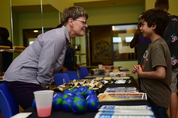Sue Kimball, Ent Credit Union lending consultant, speaks with Kai Kurtz, a Buckley Air Force Base youth, June 3, 2016, during a College and Career Expo at the youth center on Buckley AFB, Colo. The expo educated Buckley AFB's youth on the benefits of saving money at an early age and the different options available to them. (U.S. Air Force photo by Airman 1st Class Gabrielle Spradling/Released)