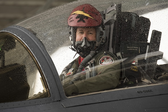 Lt. Col. Michael Landers, 389th Fighter Squadron pilot, smiles out of the cockpit of an F-15E Strike Eagle at Mountain Home Air Force Base, Idaho, May 20, 2016. After reaching 3,000 flight hours, Landers has completed 1,282 sorties and 5 deployments during his 16 year career. (U.S. Air Force photo by Airman Alaysia Berry/Released)