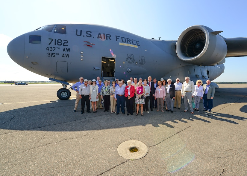 Members of the Defense Orientation Conference Association pose in front of a Globemaster III C-17 aircraft during their tour of Joint Base Charleston, S.C. June 1, 2016.  While visiting, DOCA members received a JB Charleston command mission brief, SPAWAR command brief and 841st Transportation Battalion command brief, interacted with Airmen and Sailors, viewed static equipment displays, and took a JB Charleston - Weapons Station driving tour.