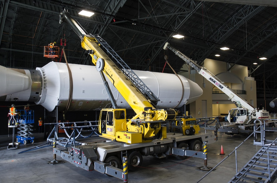 DAYTON, Ohio - Titan IVB stage two, and the payload fairing were both raised into their final position from May 12-13, 2016. Maxim Crane Works and museum restoration crews worked together using two lifts to place the final sections onto the stand. The impressive Titan IVB, with roots going back to the early days of U.S. Air Force and civil space launch, is significant as the museum looks to share the story of USAF and USAF-enabled space operations in its Space Gallery. The Titan IVB will be on display in the new fourth building at the National Museum of the U.S. Air Force which opens to the public on June 8. (U.S. Air Force photo by Ken LaRock)