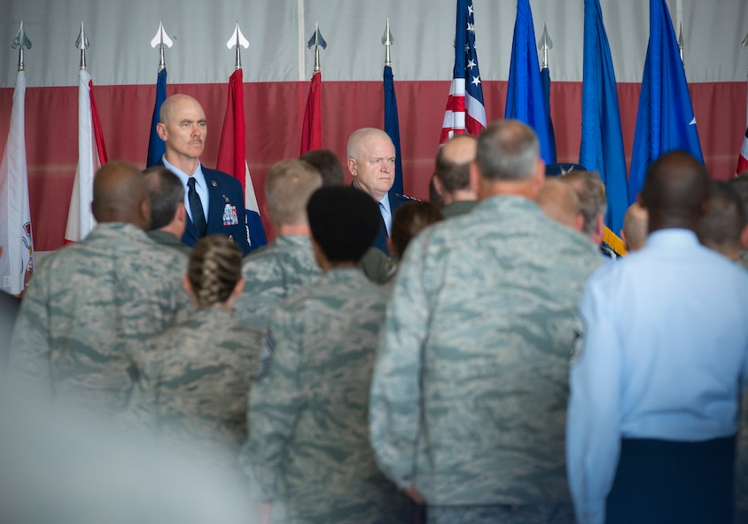 Chief Master Sergeant Ronald C. Anderson (left) and Lt. Gen. L. Scott Rice (center), director of the Air National Guard stand at attention during the playing of the national anthem at a welcome ceremony June 2, 2016, at Joint Base Andrews, Md. Anderson was introduced as the 12th command chief master sergeant for the Air National Guard. (U.S. Air National Guard photo by Master Sgt. Marvin R. Preston/Released)