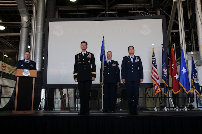 U.S. Army Maj. Gen. Jefferson Burton, Utah National Guard adjutant general, and Col. Kristin Streukens stand at attention during the 151st Air Refueling Wing assumption of command ceremony at Roland R. Wright Air National Guard Base, UT., June 4, 2016. Streukens will assume responsibility for more than 1,400 Airmen and current missions that include training and operational aerial refueling, airlift and aeromedical evacuation, intelligence, airspace control, cyber infrastructure and information operations (U.S. Air National Guard photo by Staff Sgt. Colton Elliott/Released)