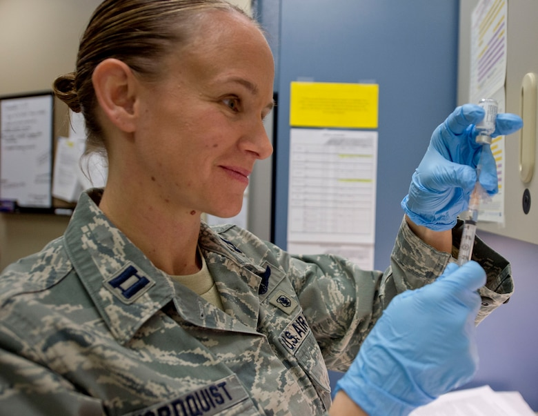 U.S. Air Force Capt. Amy Nordquist, 133rd Medical Group, fills a needle with a vaccine in St. Paul, Minn., Jan. 23, 2016. The vaccine is a mandatory requirement for the Airmen in order to stay healthy and prevent sickness.  (U.S. Air National Guard photo by Tech. Sgt. Amy M. Lovgren/Released)