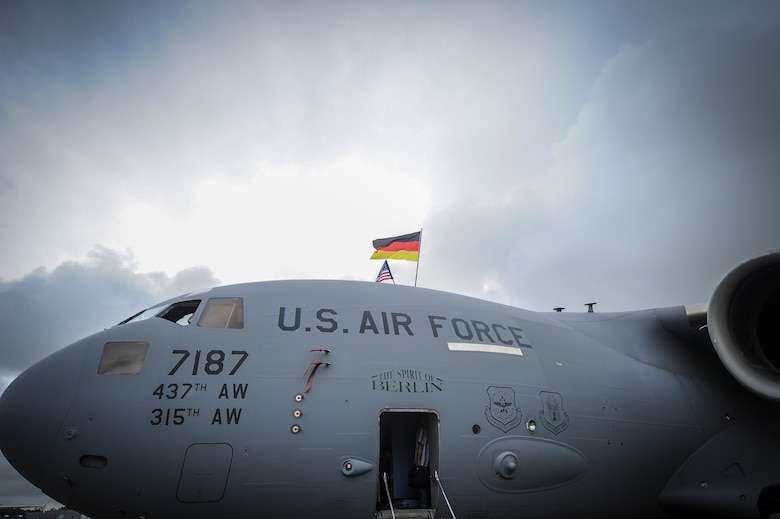 """The C-17 Globemaster III dubbed """"The Spirit of Berlin"""" towers over various aircraft during the 2016 Berlin Air Show, Germany. The aircraft arrived in Berlin from Joint Base Charleston and entertained thousands of individuals with its superior technology and mobility airlift capabilities.  (U.S. Air Force photo by Senior Airman Tom Brading)"""