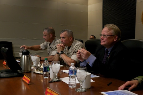 Peter Hultqvist, Sweden's Minister of Defense (right), sits in on a meeting with Lt. Gen. John E. Wissler, U.S. Marine Forces Command commanding  general, June 6, at MARFORCOM in Norfolk, Virginia. (Official U.S. Marine Corps Photo by Cpl. Calvin Shamoon/ Released)