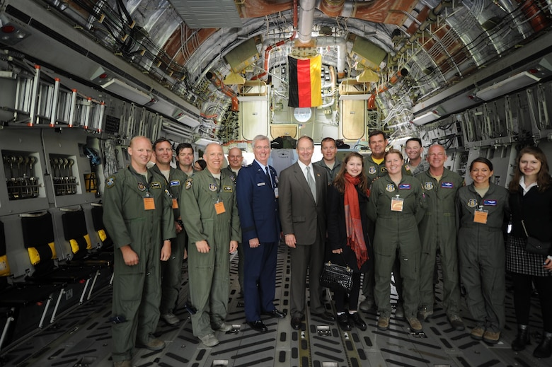 """(Center) John B. Emerson, United States Ambassador to Germany, along with Brig. Gen. """"Randy"""" Huston, mobilization assistant to the vice commander, Third Air Force and 17th Expeditionary Air Force, Ramstein Air Base, Germany, and the ambassador's daughters are welcomed abroad the C-17 Globemaster III entitled """"The Spirit of Berlin"""" June 1, 2016, during the 2016 Berlin Air Show. Emerson was confirmed by the United States Senate on Aug.1, 2013 as U.S. Ambassador to the Federal Republic of Germany and presented his credentials to German President Joachim Gauck on Aug. 26, 2013.  (U.S. Air Force photo by Senior Airman Tom Brading)"""