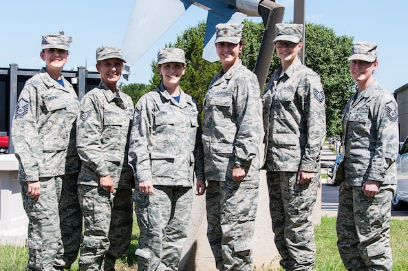 Senior Master Sgt. Lisa Pina (third from left), 301st Force Support Squadron force development superintendent, poses with members from the squadron and her flight, here June 5. Pina, along with her flight, play a vital role in developing and empowering Airmen in the 301st Fighter Wing by helping them connect to resources for degrees, like the Community College of the Air Force (CCAF), along with professional military education, such as on-the-job training or Airman Leadership School. (U.S. Air Force photo by Master Sgt. Joshua Woods)