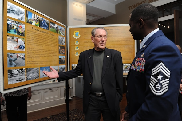 """Retired Chief Master Sgt. J.J. Vollmuth and Chief Master Sgt. Harry Hutchinson, 81st Training Wing command chief, view the 14 panel historical display during Keesler's 75th Anniversary Historical Display Unveiling at the Biloxi Visitors Center June 3, 2016, Biloxi, Miss. The newest 75th anniversary logo was also unveiled and Biloxi Mayor Andrew 'FoFo' Gilich read the """"Biloxi/Keesler Partnership Day"""" proclamation. (U.S. Air Force photo by Kemberly Groue)"""