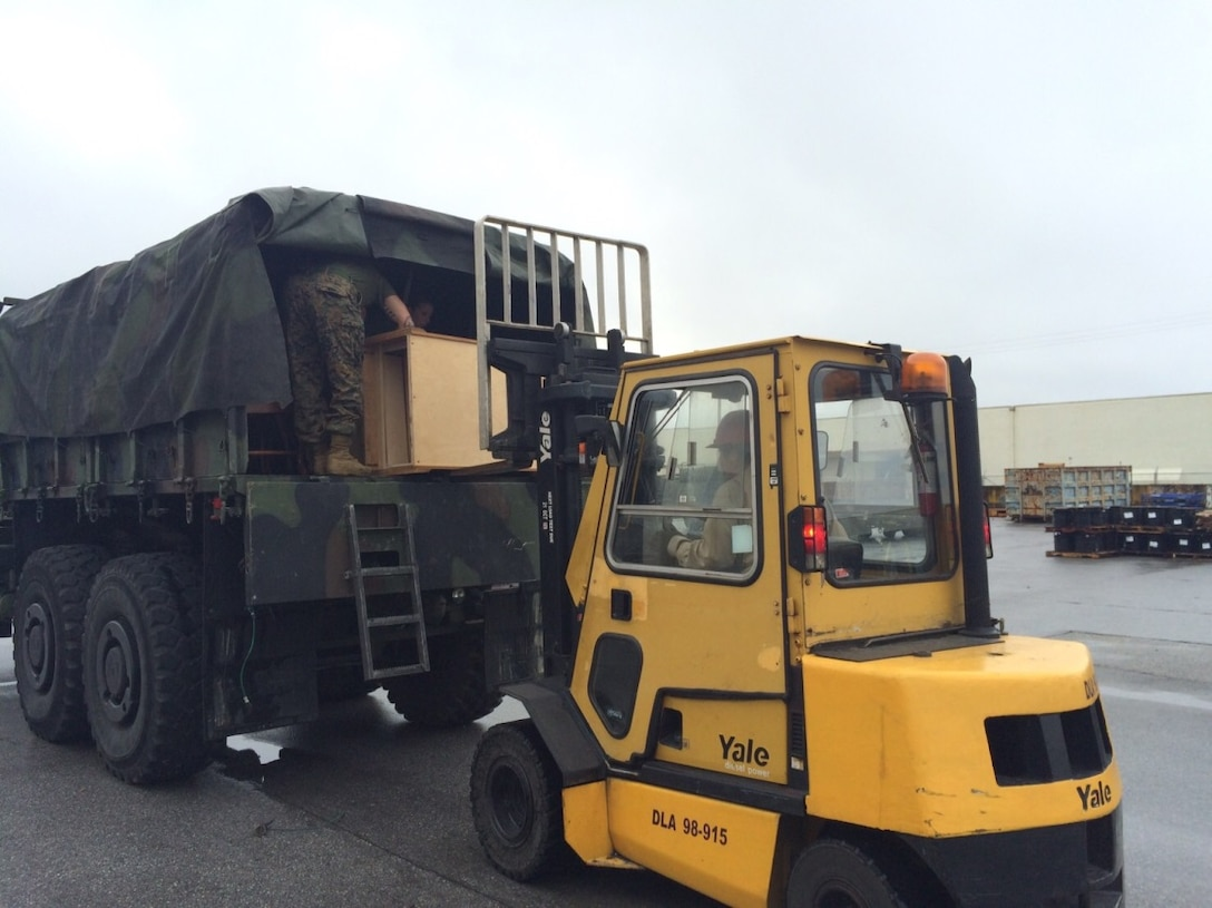 A truckload of couches, chairs, tables and wardrobes from the DLA Disposition Services site at Okinawa, Japan, is readied for shipment to a live fire training area for use by III Marine Expeditionary Force's Expeditionary Operations Training Group in a live fire training area.