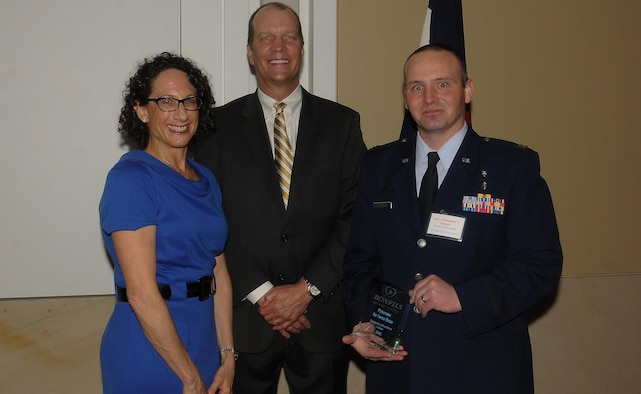 COLORADO SPRINGS, Colo. -- Capt. Christopher Harmer, 21st Medical Group, receives the Bonfils Blood Center Outstanding Blood Drive Partner award on behalf of Peterson Air Force Base for exemplary efforts in blood drive participation in 2015. Bonfils CEO Bryan Kreuger presented the award and Susan Witkin, KOA News Radio, was emcee. (Courtesy Photo)