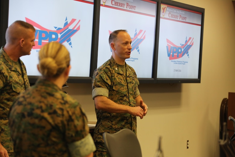 Col. Chris C. Pappas III addresses a crowd during a Voluntary Protection Program Gold status achievement ceremony at Marine Corps Air Station Cherry Point, N.C., May 27, 2016. Six departments were among the first to achieve Gold status within MCAS Cherry Point VPP. Gold status is achieved when all safety protocols implemented by the VPP are completed and maintained. Some of those requirements involve monthly supervisor inspections, achieving 90-percent medical surveillance or higher, completing VPP passports and completing Occupational Safety and Health Administration training. Pappas is the air station commanding officer. (U.S. Marine Corps photo by Cpl. N.W. Huertas/ Released)