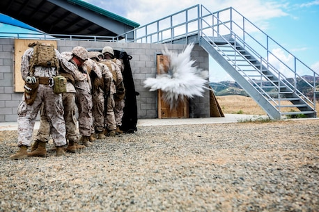U.S. Marines with the 7th Engineer Support Battalion, 1st Marine Logistics Group, go through mock breaching's as part of group training. The training includes working with simulated explosives as well as breaching doors and windows on range 211A, Camp Pendleton, Calif., May 25, 2016. (U.S. Marine Corps photo by LCpl. Salmineo Sherman Jr. Combat Camera/released)