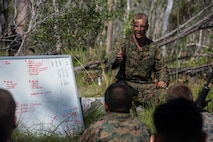 U.S. Marine Corps Capt. Chris Brock, Commanding Officer of Company A, 1st Battalion, 1st Marine Regiment, debriefs the Marines after performing platoon live fire at Shoalwater Bay, Queensland, Australia, May 22, 2016. The platoon-level live fire and maneuver was part of Exercise Southern Jackaroo, a combined training opportunity during Marine Rotational Force – Darwin (MRF-D). MRF-D is a six-month deployment of Marines into Darwin, Australia, where they will conduct exercises and train with the Australian Defence Forces, strengthening the U.S.-Australia alliance.