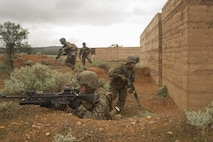 Marines with Company C, 1st Battalion, 1st Marine Regiment, move from building to building to clear them during Exercise Predator Strike at Cultana Training Area, South Australia, Australia, June 5, 2016. Predator Strike, a yearly exercise taken place in Australia with Marine Rotational Force – Darwin, allows Marines to enhance their skills and train with the Australian Defence Force.