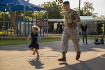 Lance Cpl. Adrian Lozano runs with a student during physical education at Larrakeyah Primary School, Northern Territory, Australia, on June 2, 2016. Marines with the Forward Coordination Element, Marine Rotational Force – Darwin, volunteered to help with classes at the school. Lozano, from Los Angeles, California, is an administration specialist with FCE, MRF-D.