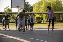 Lance Cpl. Adrian Lozano shows students how to long jump during physical education at Larrakeyah Primary School, Northern Territory, Australia, on June 2, 2016. Marines with the Forward Coordination Element, Marine Rotational Force – Darwin, volunteered to help with classes at the school. Lozano, from Los Angeles, California, is an administration specialist with FCE, MRF-D.