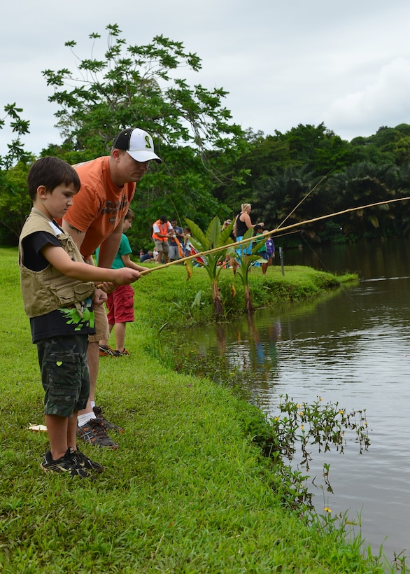 Tech. Sgt. Adam Speights, 15th Aircraft Maintenance Squadron, gives fishing tips to his son during the annual Friends of Hickam Keiki Fishing Tournament at the Ho`omaluhia Botanical Gardens in Kaneohe, Hawaii, June 2, 2016. More than 150 Airmen and their children from Joint Base Pearl Harbor-Hickam attended the fishing tournament in its 17th year. The Friends of Hickam is a non-profit organization composed of civic and business leaders in the local community who are interested in showing support for the Air Force in Hawaii. (U.S. Air Force photo by Tech. Sgt. Aaron Oelrich/Released)