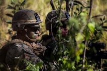 U.S. Marine Corps Lance Cpl. Miguel Santibanez, automatic rifleman, sits in the defensive position during Exercise Southern Jackaroo at Shoalwater Bay, Queensland, Australia, May 18, 2016. Conducting defensive training allows U.S. Marines and Australian service members to share techniques, tactics and procedures to improve their defensive skills during Marine Rotational Force – Darwin (MRF-D). MRF-D is a six-month deployment of Marines into Darwin, Australia, where they will conduct exercises and train with the Australian Defence Forces, strengthening the U.S.-Australia alliance.