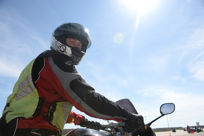 Senior Master Sgt. Gordon Comerford, 28th Munitions Squadron flight chief and rider course instructor, revs his motorcycle while wearing the proper personal equipment during a basic riders' course at Ellsworth Air Force Base, S.D., May 19, 2016.The proper personal equipment required for riders on Ellsworth are a Department of Transportation approved helmet, eye protection, long-sleeves, full-fingered gloves, pants and sturdy over the ankle footwear. (U.S. Air Force photo by Airman 1st Class Sadie Colbert/Released)