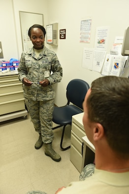 U.S Air Force Tech. Sgt. Raven Taylor, 489th Aerospace Medical Flight junior Air Reserve technician, performs a personal health assessment on Master Sgt. Wade Melick, 489th AMDF senior Air Reserve technician, June 3, 2016, at the 7th Medical Group, Dyess Air Force Base, Texas. Flight and operational medicine clinics required patients to travel between departments to accomplish pre-placement exams; however, under the Base Operational Medicine Clinic, all Airman readiness and occupational exam components will be centralized to one location. (U.S. Air Force photo by Airman 1st Class Quay Drawdy/Released)