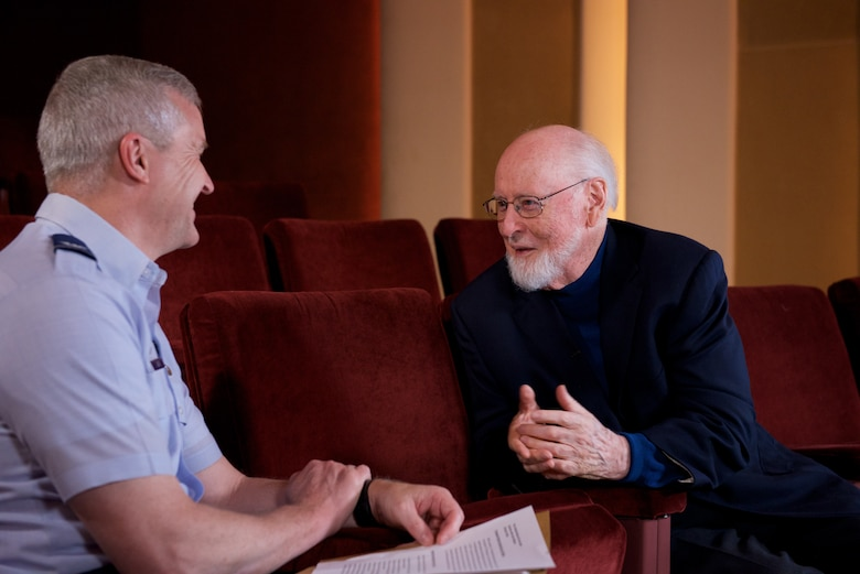 Legendary conductor and composer John Williams talks about his time in the U. S. Air Force with Col. Larry Lang, commander of the U.S. Air Force Band. Williams served as a pianist and brass player, arranging and writing as a secondary duty, though extensively. (U.S. Air Force Photo/CMSgt Bob Kamholz)
