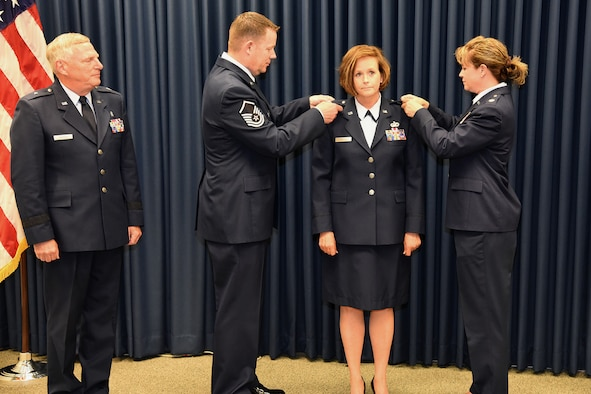 Col. Laurie Tidemann, HQ SDANG strategic plans officer, is pinned with her new rank by her siblings, Master Sgt. Eric Tidemann, 114th Fighter Wing recruiting office supervisor, and Major Lisa Tidemann, 114th Logistics Readiness Squadron officer, in a ceremony held at Joe Foss Field, S.D. June 4, 2016.  The Tidemann family has a long line of service in the South Dakota Air National Guard starting with the father, retired Col. Merlyn Tidemann, former 114th Maintenance Group commander. (U.S. Air National Guard photo by Staff Sgt. Luke Olson/Released)