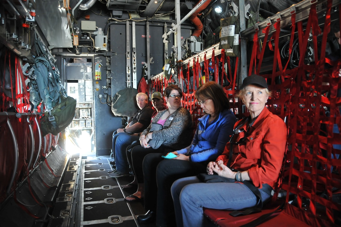 Employer Susan Grenz watches loadmasters prepare the C-130 Hercules cargo aircraft for landing June 4, at the Great Falls International Airport. Grenz was one of 40 employers who received a familiarization flight during the Employer Support of the Guard and Reserve Boss Lift. (U.S. Air National Guard photo/Technical Sgt. Michael Touchette)