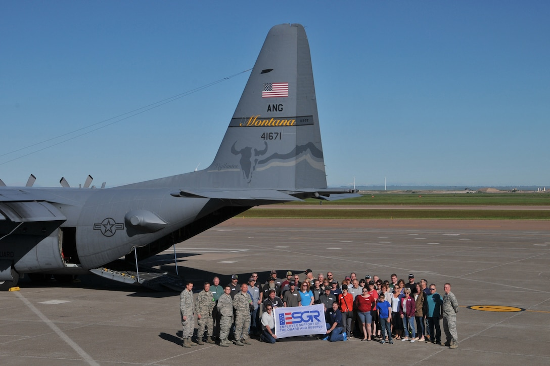 Participants of the Employer Support of the Guard and Reserve Boss Lift event assemble on the flight line before boarding C-130 Hercules cargo aircraft June 4, at the Great Falls International Airport. The program promotes cooperation and understanding between Reserve Component service members and their civilian employers. (U.S. Air National Guard photo/Technical Sgt. Michael Touchette)