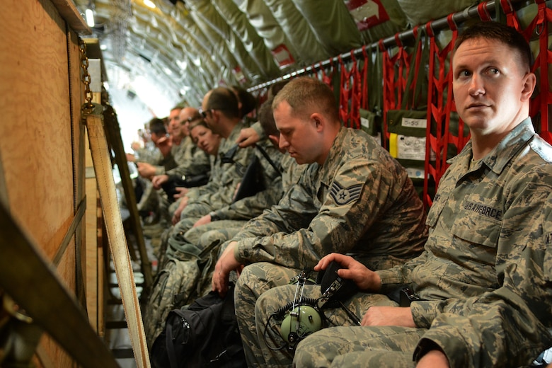 Airmen from the 115th Fighter Wing sit in a KC-135 Stratotanker prior to departure from Dane County Regional Airport, Madison, Wis., May 6, 2016. The 115 FW travelled to Tyndall Air Force Base, Fla., for a training exercise called Combat Archer which allowed pilots, maintainers and operations Airmen an opportunity to train with live missiles. (U.S. Air National Guard Photo by Senior Airman Kyle Russell)
