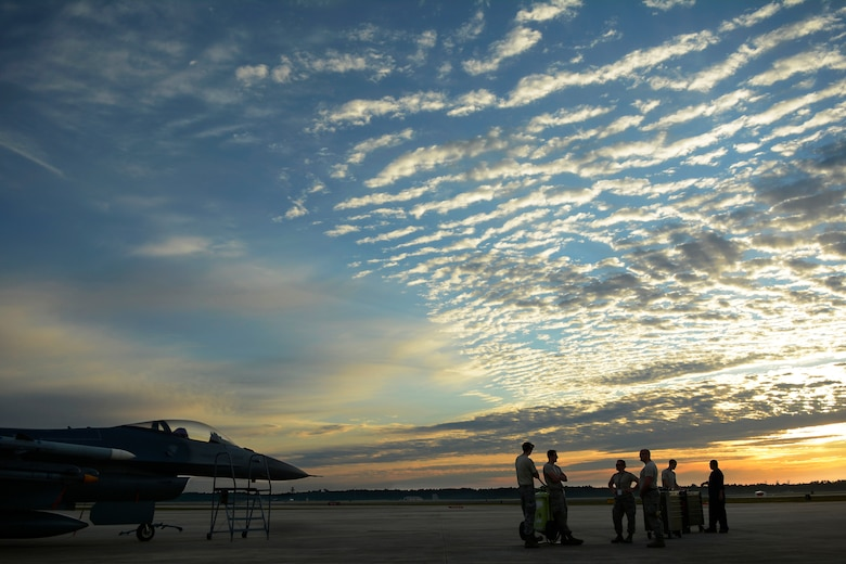 Airmen from the 115th Fighter Wing prepare for the first flight of the day at Tyndall Air Force Base, Fla., May 9, 2016. The 115 FW travelled to Tyndall AFB for a training exercise called Combat Archer which allowed pilots, maintainers and operations Airmen an opportunity to train with live missiles. (U.S. Air National Guard Photo by Senior Airman Kyle Russell)