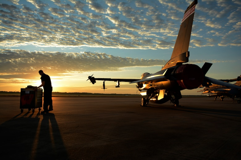 Staff Sgt. Paul Epping, 115th Fighter Wing crew chief, prepares jet for the pre-flight check at Tyndall Air Force Base, Fla., May 9, 2016. The 115 FW travelled to Tyndall AFB for a training exercise called Combat Archer which allowed pilots, maintainers and operations Airmen an opportunity to train with live missiles. (U.S. Air National Guard Photo by Senior Airman Kyle Russell)