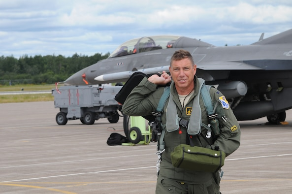 Brig. Gen. Frank H. Stokes walks across the ramp at the 148th Fighter Wing, Duluth, Minn. Aug. 3, 2015.  Stokes, former 148th Fighter Wing Commander, has been appointed to the role of Deputy Director of Regional Engagements for U.S. Africa Command (U.S. AFRICOM), stationed at United States Army Garrison Stuttgart, Germany.