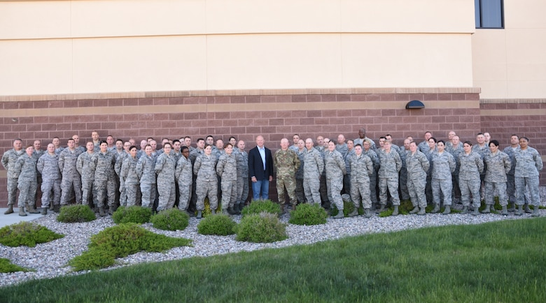 Deploying airmen from the 153rd Airlift Wing, Wyoming Air National Guard, pose for a photo with Wyoming Gov. Matt Mead and Wyoming Adjutant General, Maj. Gen. K. Luke Reiner June 5, 2016. Mead and Reiner made it a priority to talk with these airmen prior to their upcoming deployments. (U.S. Air National Guard photo by Senior Airman Nichole Grady)