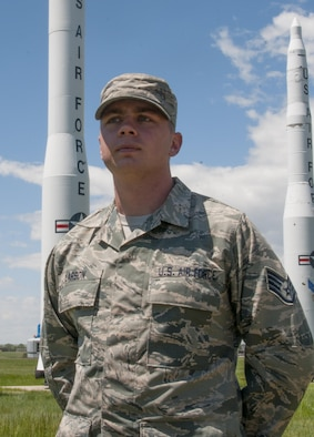 Staff Sgt. Alex Larson, 90th Medical Operations Squadron flight and operations medicine technician, poses in front of the missile display on F.E. Warren Air Force Base, Wyo., June 1, 2016. Larson is slated to attend Officer Training School in early 2017, then attend technical school to become a missileer. (U.S. Air Force photo by Senior Airman Jason Wiese)