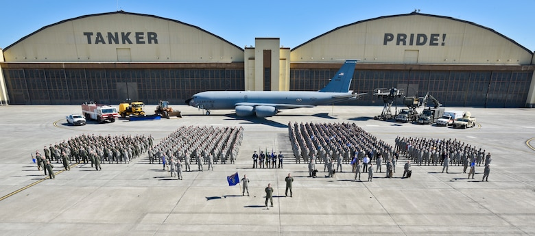 92nd Air Refueling Wing personnel stand proudly for the annual wing photo in front of building 2050, May 2016. Historically, wing photos have been taken in front of the adorned Tanker Pride, because the building is arguably the anchor and icon of Fairchild. In addition, wing change of commands are conducted on the other side of building 2050 where it reads Global Reach For America. (U.S. Air Force photo/Airman 1st Class Taylor Shelton)