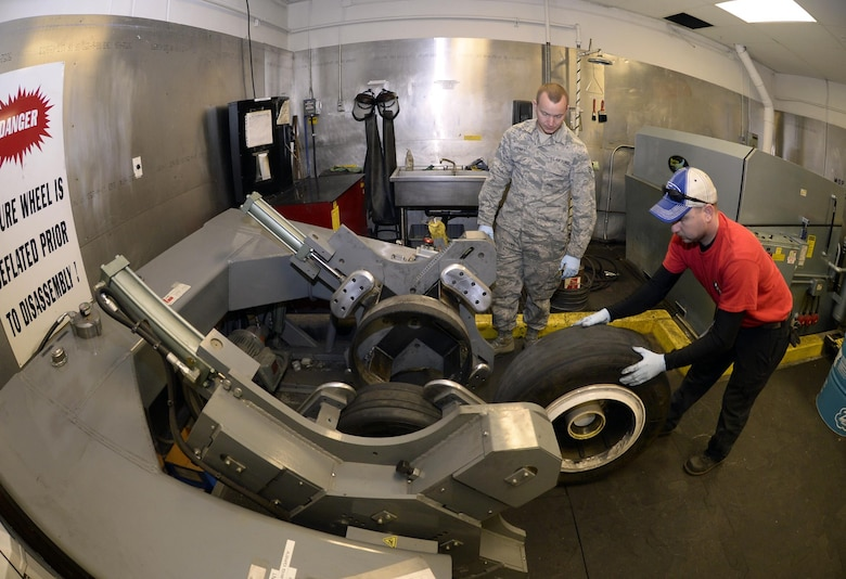 Tech. Sgt. James Speicher, right, an air reserve technician with the 419th Maintenance Squadron, rolls an F-35 Lightning II wheel into a tire changing machine May 20, 2016, while Senior Airman Joseph Sprowls, of the 388th Maintenance Squadron, looks on in the wheel and tire shop at Hill Air Force Base, Utah. The machine depicted is a legacy tool which has been adapted via a fabricated bead breaker to be used in changing F-35 tires. (U.S. Air Force photo/Todd Cromar)