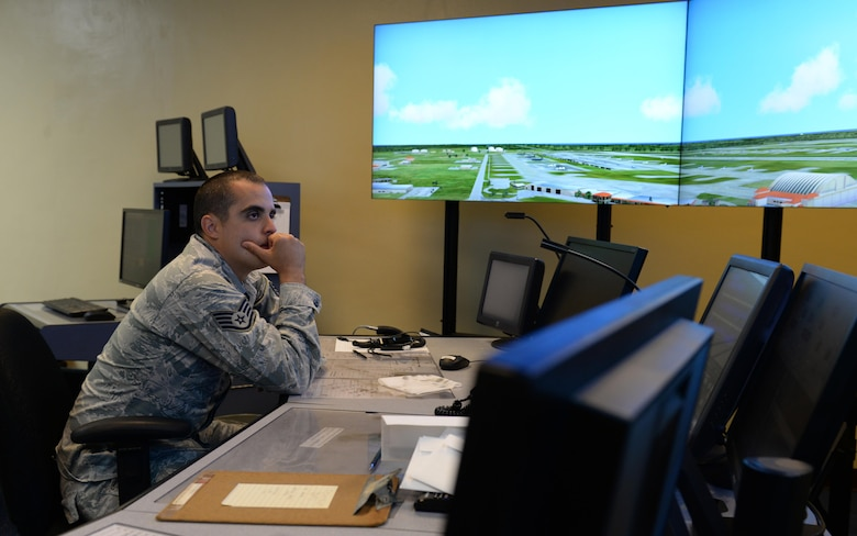 Staff Sgt. Nicholas Barsenas, 36th Operations Support Squadron air traffic controller, uses a tower simulation system June 2, 2016, at Andersen Air Force Base, Guam. Air traffic controllers train during normal operations to handle heavy flightline traffic during exercises including Cope North and Valiant Shield. (U.S. Air Force photo by Airman 1st Class Jacob Skovo)