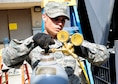 Staff Sgt. Elvis Pabon, 8th Civil Engineer Squadron Heating, Ventilation, and Air Conditioning journeyman, checks for leaks in an air refrigerating machine at the base theater June 7, 2016. The Wolf Pack relies on the individuals from the HVAC shop to help keep the mission going. (U.S. Air Force photo/Staff Sgt. Chelsea Browning)