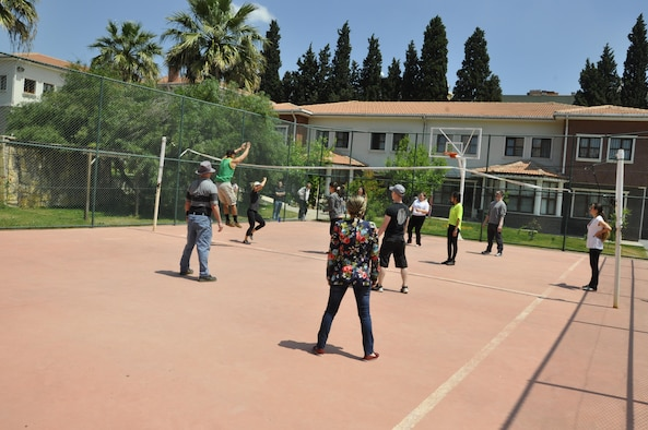 Turkish girls and their guests from NATO and the 425th ABS enjoy a volleyball game at a local girls' care and rehabilitation center.
