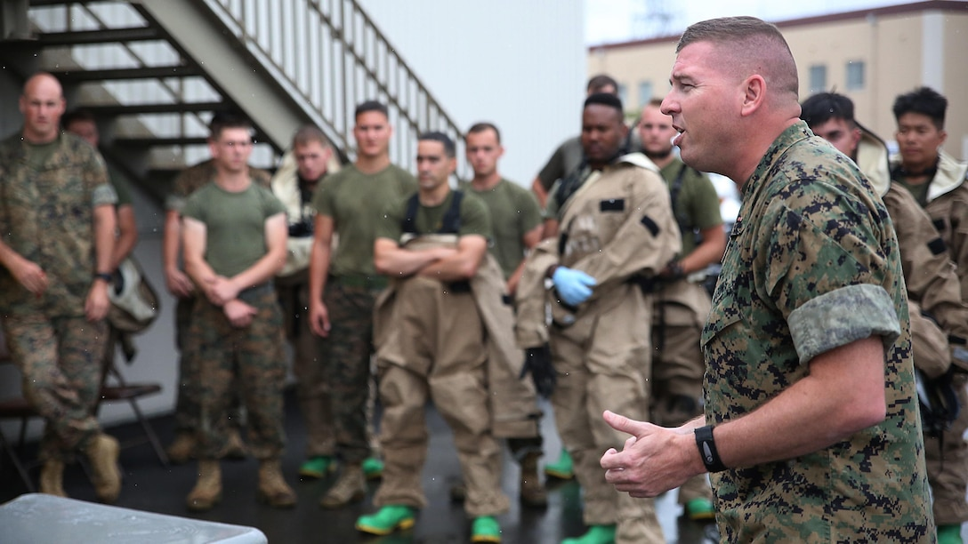 U.S. Marine Corps Chief Warrant Officer Christopher Joy, Chemical, Biological, Radiological and Nuclear defense officer with 3rd Marine Division, CBRN defense platoon, Headquarters Battalion, III Marine Expeditionary Force, mentors his Marines before they respond to a simulated CBRN threat during exercise Habu Sentinel  16, at Disaster Village, Marine Corps Air Station Iwakuni, Japan, June 6, 2016. As the annual capstone exercise for the division's response element, this event encompasses multiple objectives specific to CBRN response and validates unit standard operating procedures in an unfamiliar training environment.