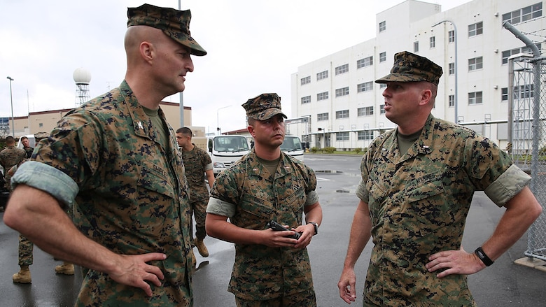 From left to right, U.S. Marine Corps Col. Daniel Shipley, commanding officer of Marine Aircraft Group 12, Chief Warrant Officer Jonathan B. Davis, Chemical, Biological, Radiological and Nuclear officer in charge with MAG-12, and Chief Warrant Officer Christopher Joy, CBRN defense officer with 3rd Marine Division, CBRN defense platoon, Headquarters Battalion, III Marine Expeditionary Force, discuss mission objectives during exercise Habu Sentinel 16, at Disaster Village, Marine Corps Air Station Iwakuni, Japan, June 7, 2016. Third Marine Division CBRN Marines traveled to MCAS Iwakuni for this event and worked with MAG-12 personnel in developing technical skills critical to their profession.  As the annual capstone exercise for the division's response element, this event encompasses multiple objectives specific to CBRN response and validates unit standard operating procedures in an unfamiliar training environment.