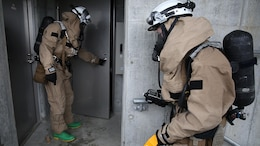 U.S. Marines from 3rd Marine Division, Chemical, Biological, Radiological and Nuclear defense platoon, Headquarters Battalion, III Marine Expeditionary Force, prepare to enter a room suspected of hazardous materials during exercise Habu Sentinel 16 at Disaster Village, Marine Corps Air Station Iwakuni, Japan, June 7, 2016. As the annual capstone exercise for the division's response element, this event encompasses multiple objectives specific to CBRN response and validates unit standard operating procedures in an unfamiliar training environment.