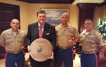 Clay Bennett, owner, Oklahoma City Thunder, stands with members of Marine Corps Recruiting Station Oklahoma City after being presented with a shield and coin in his office, June 1, 2016. The shield and coin were presented to Mr. Bennett by Maj. Ryan Cohen, Commanding Officer, for the support he has shown the Marines in the area.