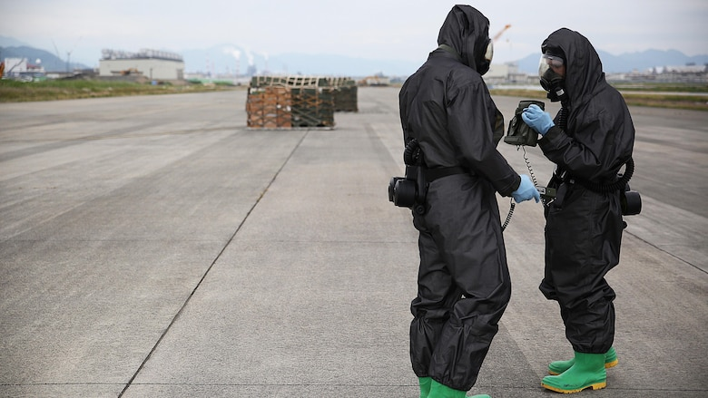 U.S. Marines from 3rd Marine Division, Chemical, Biological, Radiological and Nuclear defense platoon, Headquarters Battalion, III Marine Expeditionary Force, prepare to respond to contaminated cargo during exercise Habu Sentinel 16 at Marine Corps Air Station Iwakuni, Japan, June 7, 2016. Marine Aerial Refueler Transport Squadron 152, stationed at MCAS Iwakuni, assisted in the scenario by providing a taxiway combat off-load. Pallets suspected of radiological contamination slid from the cargo bay of a KC-130J Super Hercules onto the taxiway where CBRN Marines were staged nearby in order to respond swiftly and effectively.  As the annual capstone exercise for the division's response element, this event encompasses multiple objectives specific to CBRN response and validates unit standard operating procedures in an unfamiliar training environment.