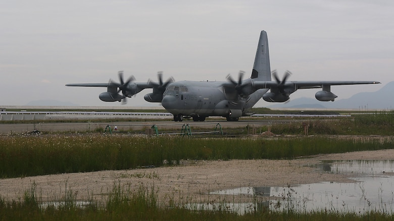 A KC-130J Super Hercules moves down taxiway Charlie at Marine Corps Air Station Iwakuni, Japan, after providing a combat off-load of pallets suspected of radiological contamination during exercise Habu Sentinel 16, June 6, 2016. Marine Aerial Refueler Transport Squadron 152, stationed at MCAS Iwakuni, assisted in this scenario for the exercise so U.S. Marines from 3rd Marine Division, Chemical, Biological, Radiological and Nuclear defense platoon, Headquarters Battalion, III Marine Expeditionary Force, could appropriately respond to the situation and practice reacting to possible real-world operations. As the annual capstone exercise for the division's response element, this event encompasses multiple objectives specific to CBRN response and validates unit standard operating procedures in an unfamiliar training environment.