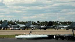 Maintainers from Marine All-Weather Fighter Attack Squadron 242 perform after-flight inspections and repairs to the squadron's F/A-18D aircraft in preparation for exercise Red Flag-Alaska 16-2 at Eielson Air Force Base, Alaska, June 4, 2016. Exercise Red Flag-Alaska 16-2 provides VMFA-314 and Marine All-Weather Fighter Attack Squadron 242, based out of Marine Corps Station Iwakuni, Japan, the opportunity to train with joint and international units, increasing their combat skills by participating simulated combat situations in a realistic threat environment.