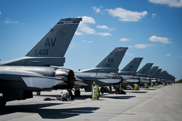 Airmen from the 31st Aircraft Maintenance Squadron prepare F-16 Fighting Falcons from the 31st Fighter Wing, Aviano Air Base, Italy, before a sortie during Aviation Detachment Rotation 16-3 at Lask Air Base, Poland, June 7, 2016. During this deployment 14 F-16 Fighting Falcons from the 31st FW, Aviano Air Base, Italy, six F-16s from the 138 FW, Tulsa Air National Guard, Okla., and support personnel will conduct bilateral training with Poland air forces to bolster interoperability between nations. (U.S. Air Force photo/Senior Airman Erin Babis)