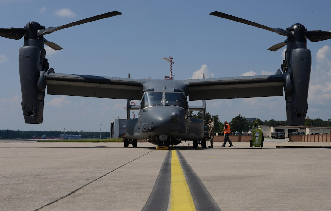 An Airman from the 7th Special Operations Squadron at Royal Air Force Mildenhall, England, prepares a CV-22 Osprey for departure at Ramstein Air Base, Germany, June 6, 2016. The CV-22 crew were returning to Mildenhall from the D-Day remembrance airdrops in Normandy, France, and stopped by Ramstein to pick up their squadron members returning from a deployment. (U.S. Air Force Photo/ Airman 1st Class Joshua Magbanua)